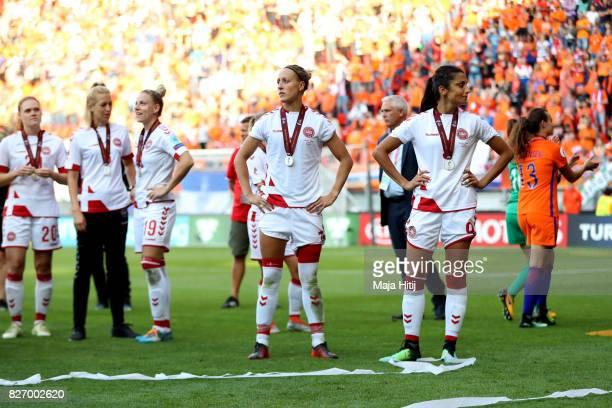 Denmark players look dejected following the Final of the UEFA Women's Euro 2017 between Netherlands v Denmark at FC Twente Stadium on August 6 2017...