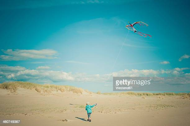 Denmark, Romo, Boy flying kite at North Sea