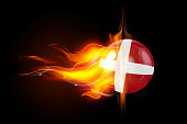 High quality render of 3D soccer ball is burning in flames on black background. 3D rendering.