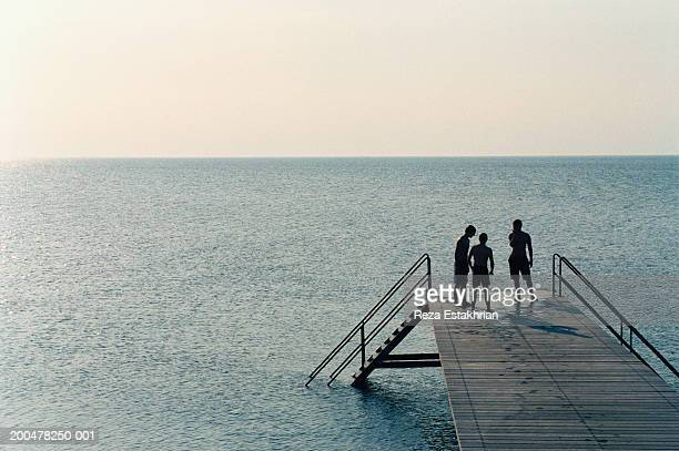 Denmark, teenagers standing on pier