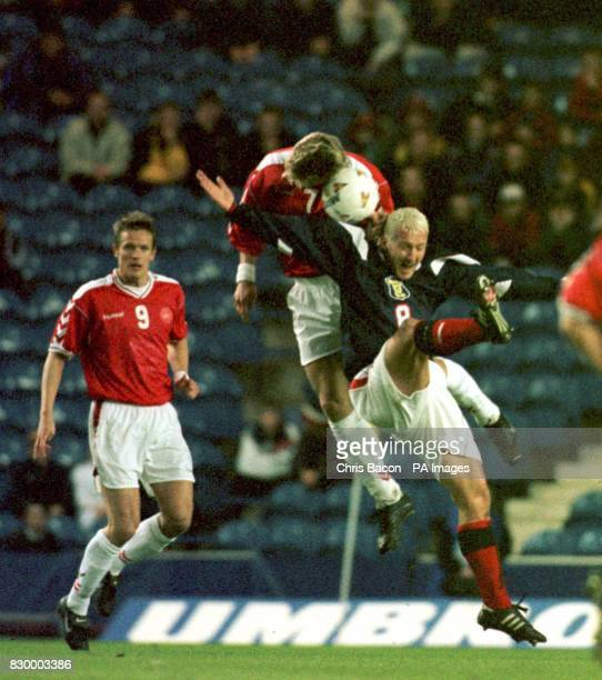 Denmark's ANielsen under pressure as from Scotland's Billy McKinlay he heads the ball during this evening's International clash at Ibrox Park Photo...