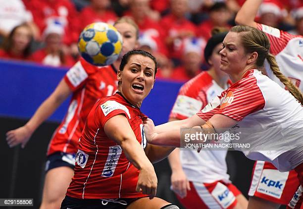 Denmark's Anne Mette Hansen tries to stop Norway's Nora Mork as she throws the ball during the Women's European Handball Championship Group II match...