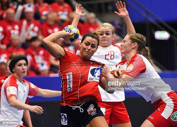 Denmark's Anne Mette Hansen tries to stop Norway's Nora Mork as she prepares to throw the ball during the Women's European Handball Championship...