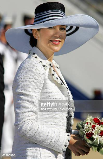 Denmark's Australianborn Crown Princess Mary Donaldson sports a broad rimmed sun hat upon the royal couple's arrival in Canberra 08 March 2005 The...