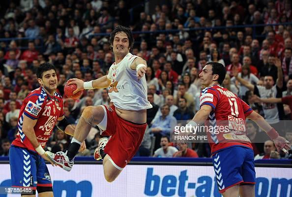 Denmark's Bo Spellerberg jumps to score in front of Serbia's Nenad Vuckovic and Rajko Prodanovic during the men's EHF Euro 2012 Handball Championship...