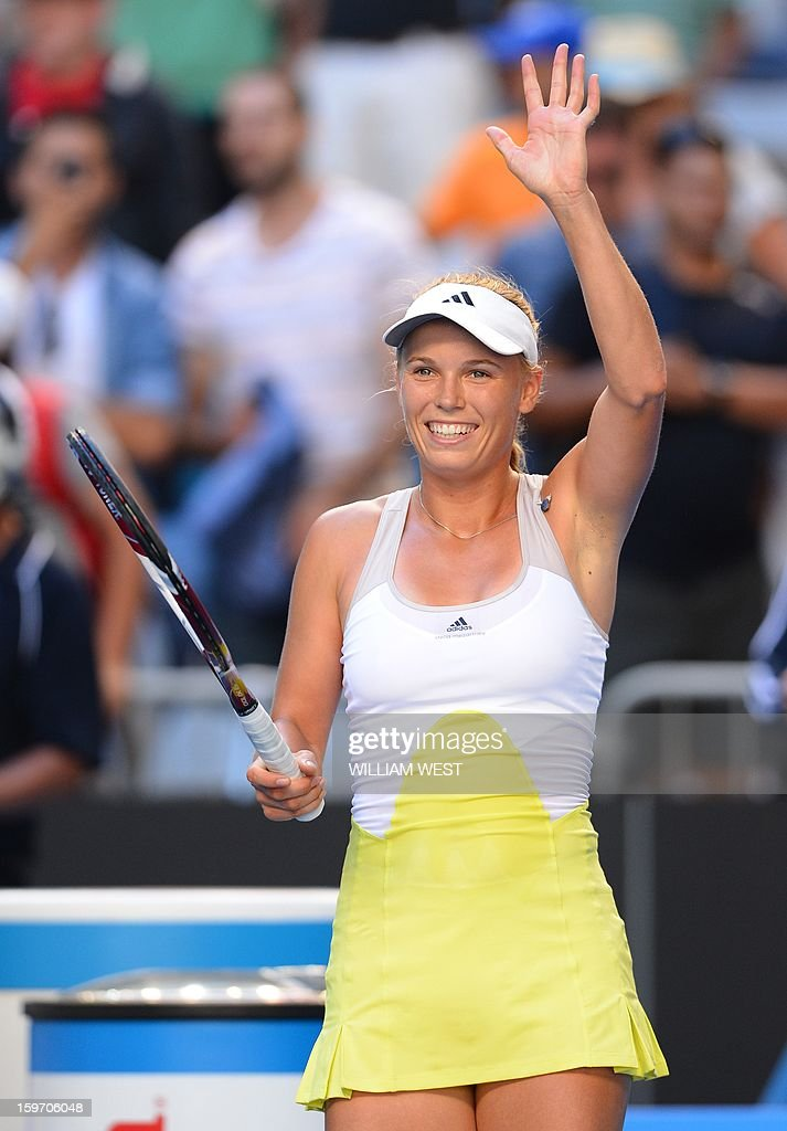 Denmark's Caroline Wozniacki celebrates after beating Ukraine's Lesia Tsurenko during their women's singles match on day six of the Australian Open tennis tournament in Melbourne on January 19, 2013.