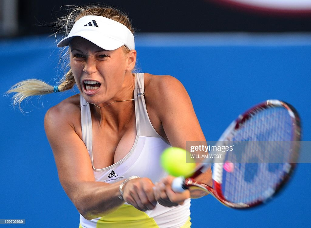 Denmark's Caroline Wozniacki hits a return against Ukraine's Lesia Tsurenko during their women's singles match on day six of the Australian Open tennis tournament in Melbourne on January 19, 2013.