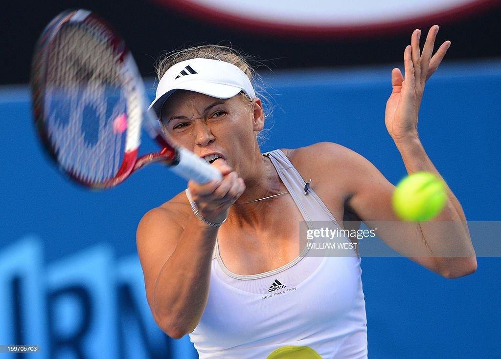 Denmark's Caroline Wozniacki hits a return against Ukraine's Lesia Tsurenko during their women's singles match on day six of the Australian Open tennis tournament in Melbourne on January 19, 2013.
