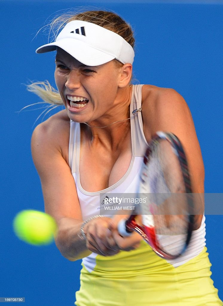 Denmark's Caroline Wozniacki hits a return against Ukraine's Lesia Tsurenko during their women's singles match on day six of the Australian Open tennis tournament in Melbourne on January 19, 2013. AFP PHOTO / WILLIAM WEST IMAGE STRICTLY RESTRICTED TO EDITORIAL USE - STRICTLY NO COMMERCIAL USE