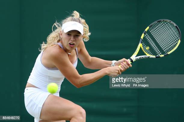 Denmark's Caroline Wozniacki in action against Canada's Aleksandra Wozniak during the Wimbledon Championships 2008 at the All England Tennis Club in...