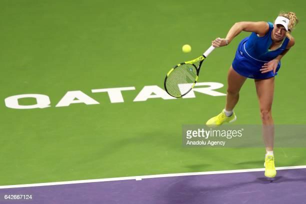 Denmark's Caroline Wozniacki is in action against Karolina Pliskova of the Czech Republic during their final tennis match within the WTA Qatar Total...