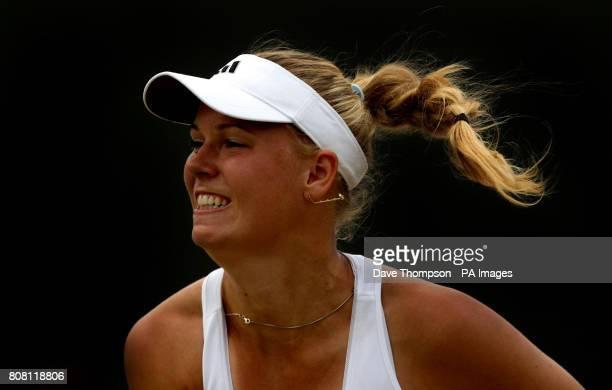 Denmark's Caroline Wozniacki plays a shot during her match against Russia's Agnieszka Pavlyuchenkova during day six of the 2010 Wimbledon...