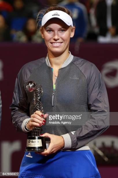 Denmark's Caroline Wozniacki poses for a picture with his trophy for after losing final tennis match against Karolina Pliskova of the Czech Republic...