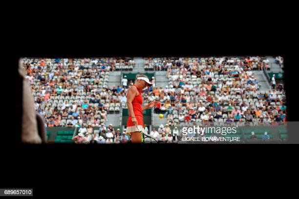 TOPSHOT Denmark's Caroline Wozniacki prepares to serve to Australia's Jaimee Fourlis during their tennis match at the Roland Garros 2017 French Open...