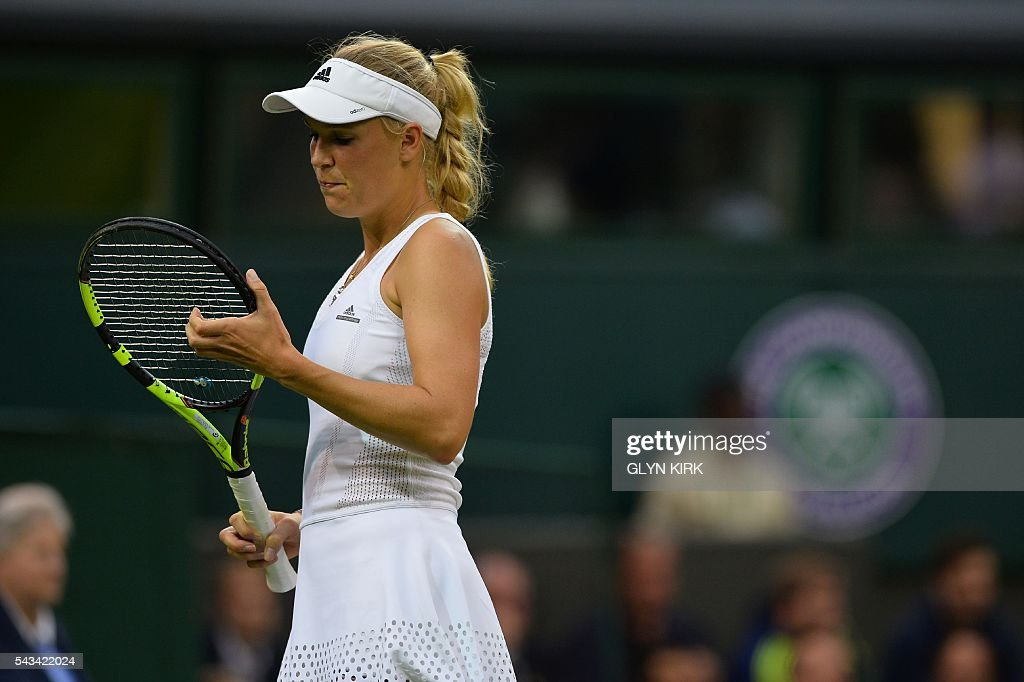 Denmark's Caroline Wozniacki reacts after a point against Russia's Svetlana Kuznetsova during their women's singles first round match on the second day of the 2016 Wimbledon Championships at The All England Lawn Tennis Club in Wimbledon, southwest London, on June 28, 2016. / AFP / GLYN