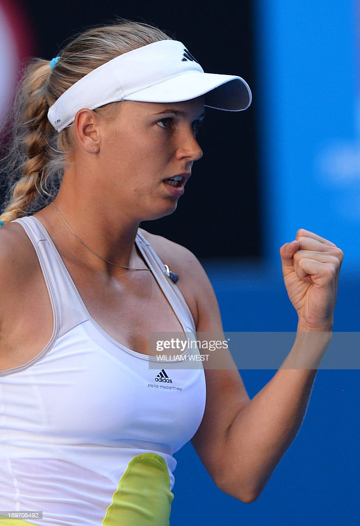 Denmark's Caroline Wozniacki reacts after a point against Ukraine's Lesia Tsurenko during their women's singles match on day six of the Australian Open tennis tournament in Melbourne on January 19, 2013. AFP PHOTO / WILLIAM WEST IMAGE STRICTLY RESTRICTED TO EDITORIAL USE - STRICTLY NO COMMERCIAL USE