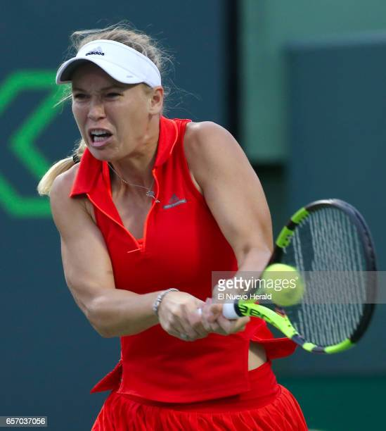 Denmark's Caroline Wozniacki returns a shot to Varvara Lepchenko of the United States during their match in the second round of the Miami Open at...