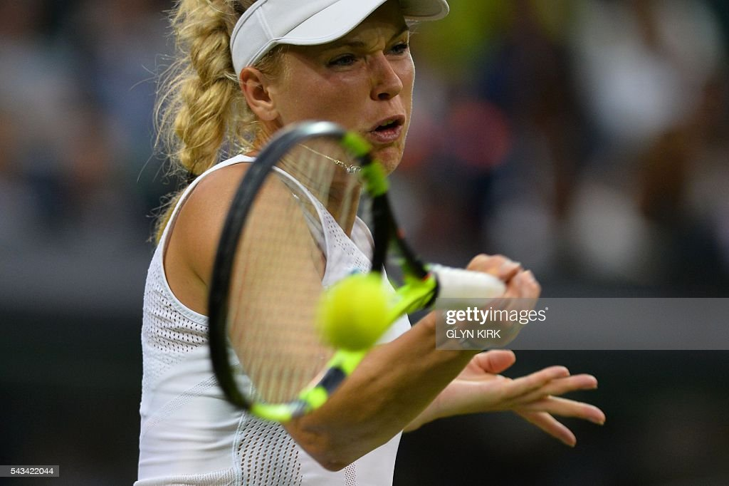 Denmark's Caroline Wozniacki returns against Russia's Svetlana Kuznetsova during their women's singles first round match on the second day of the 2016 Wimbledon Championships at The All England Lawn Tennis Club in Wimbledon, southwest London, on June 28, 2016. / AFP / GLYN