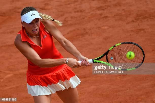 Denmark's Caroline Wozniacki returns the ball to Australia's Jaimee Fourlis during their tennis match at the Roland Garros 2017 French Open on May 29...