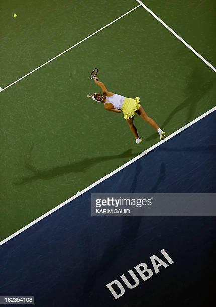 Denmark's Caroline Wozniacki serves the ball to Czech Republic's Petra Kvitova during their WTA Dubai Open semifinal tennis match in the Gulf emirate...