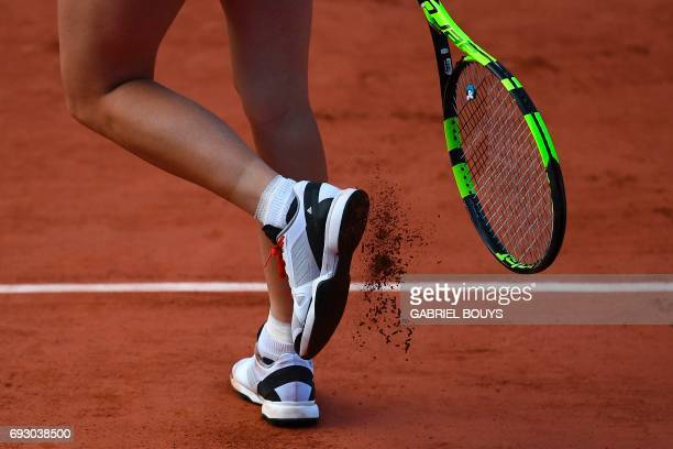 Denmark's Caroline Wozniacki's shoes are seen as she returns the ball to Latvia's Jelena Ostapenko during their tennis match at the Roland Garros...