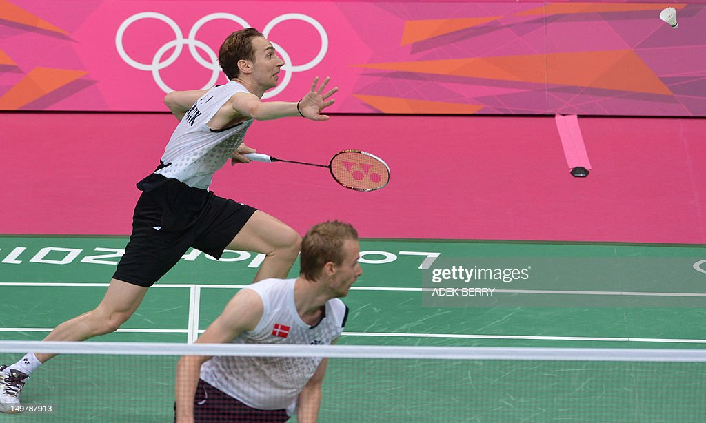 Denmark's Carsten Mogensen (R) and Mathias Boe (L) play a shot during the semi-final men's doubles badminton match against Chung Jae Sung and Lee Yong Dae of South Korea at the London 2012 Olympic Games in London on August 4, 2012. Denmark won the match 17-21, 21-18, 22-20.
