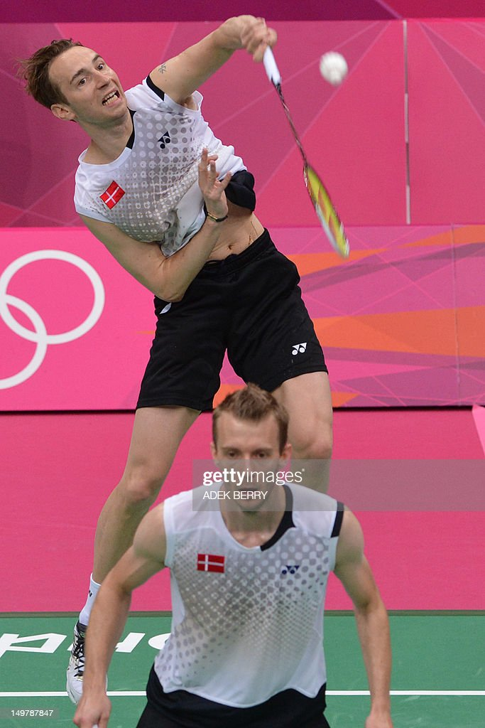 Denmark's Carsten Mogensen (R) and Mathias Boe (L) plays a shot during the semi-final men's doubles badminton match against Chung Jae Sung and Lee Yong Dae of South korea at the London 2012 Olympic Games in London on August 4, 2012. Denmark won the match 17-21, 21-18, 22-20.