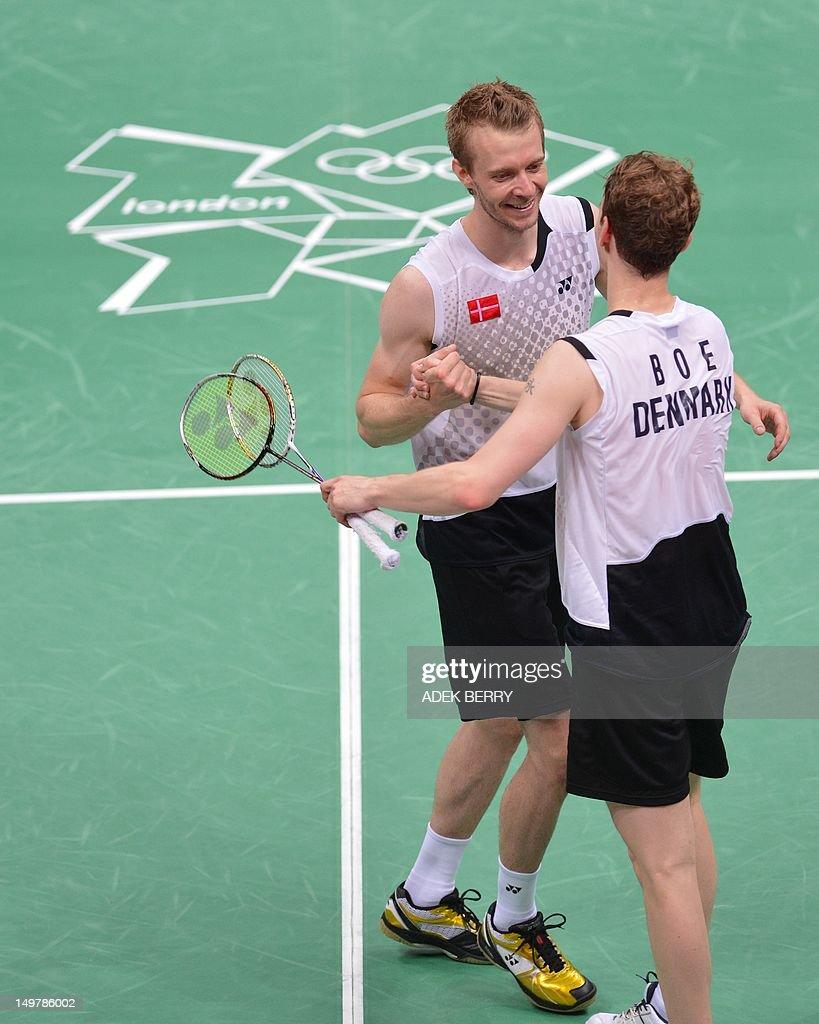 Denmark s Carsten Mogensen shakes hand w