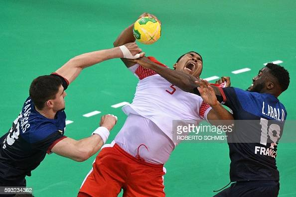 TOPSHOT Denmark's centre back Mads Mensah Larsen vies with France's pivot Ludovic Fabregas and France's right wing Luc Abalo during the men's Gold...