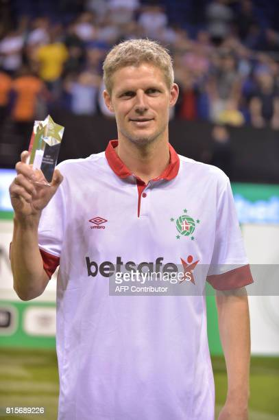 CORRECTION Denmark's Chris Sorensen poses with his award after being named star of the tournament after the Star Sixes final football match between...