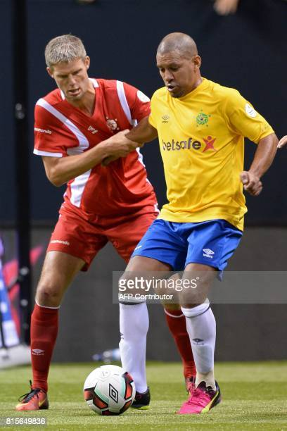 CORRECTION Denmark's Chris Sorensen vies with Brazil's Djalminha during the Star Sixes semifinal football match between Denmark and Brazil at the O2...