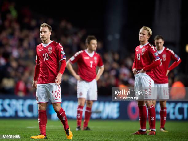 Denmark's Christian Eriksen and Kasper Dolberg react after the FIFA World Cup 2018 qualification football match between Denmark and Romania in...