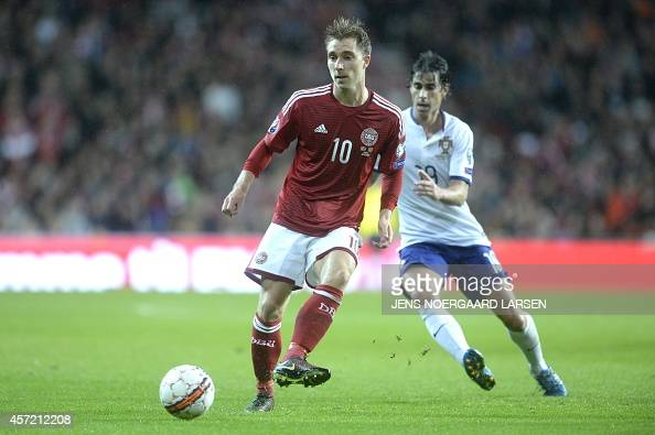 Denmark's Christian Eriksen and Portugal's Tiago vies for the ball during the UEFA Euro 2016 Group I qualifying football match Denmark vs Portugal in...