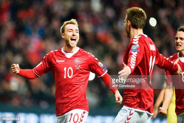 Denmark's Christian Eriksen is congratulated by teammates after scoring a goal during the FIFA World Cup 2018 qualification football match between...