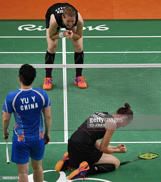 Denmark's Christinna Pedersen and Denmark's Kamilla Rytter Juhl react after winning against China's Tang Yuanting and China's Yu Yang during their...