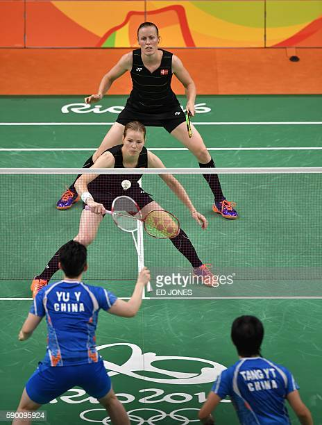 Denmark's Christinna Pedersen and Denmark's Kamilla Rytter Juhl return against China's Tang Yuanting and China's Yu Yang during their women's doubles...