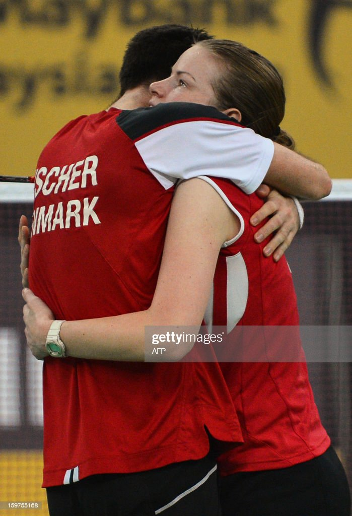 Denmark's Christinna Pedersen (R) and Joachim Fischer Nielsen (L) celebrate their victory after defeating Malaysia's Peng Soon Chan and Liu Ying Goh in the mixed doubles final at the Malaysia Open Badminton Superseries in Kuala Lumpur on January 20, 2013.