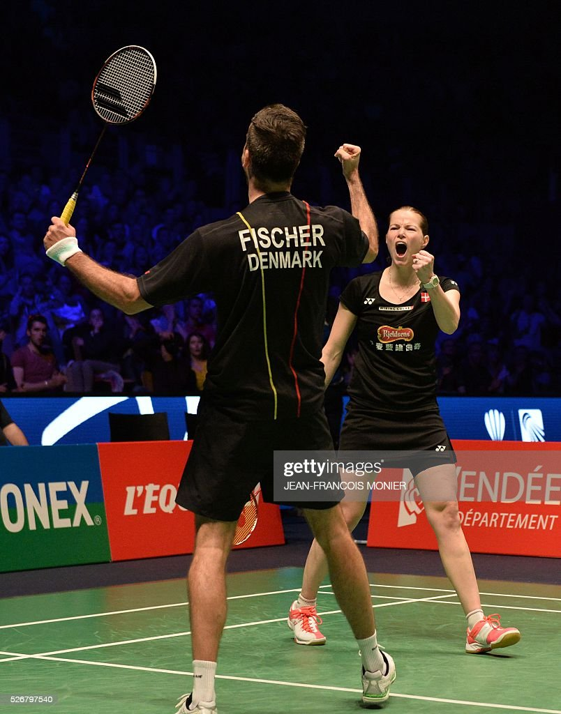 Denmark's Christinna Pedersen and teammate Joachim Fischer Nielsen celebrate after winning their 2016 European Championships Badminton mixed doubles final match in Mouilleron-le-Captif, western France, on May 1, 2016. / AFP / JEAN