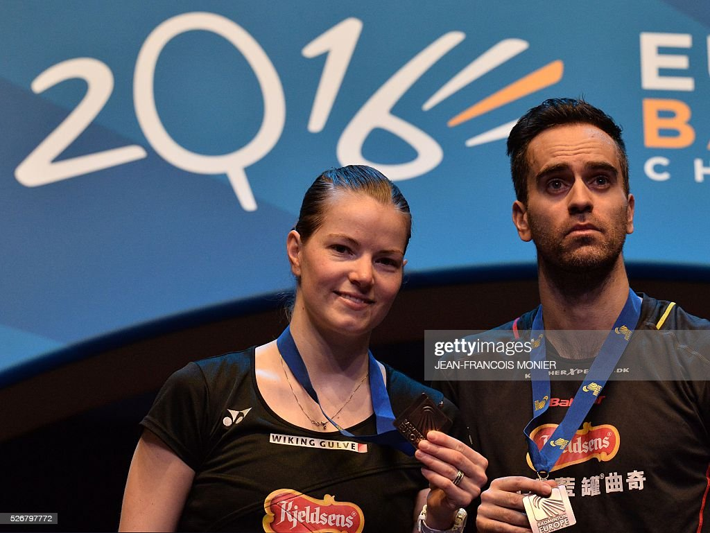 Denmark's Christinna Pedersen (L) and teammate Joachim Fischer Nielsen pose with their medals after winning their 2016 European Championships Badminton mixed doubles final match in Mouilleron-le-Captif, western France, on May 1, 2016. / AFP / JEAN