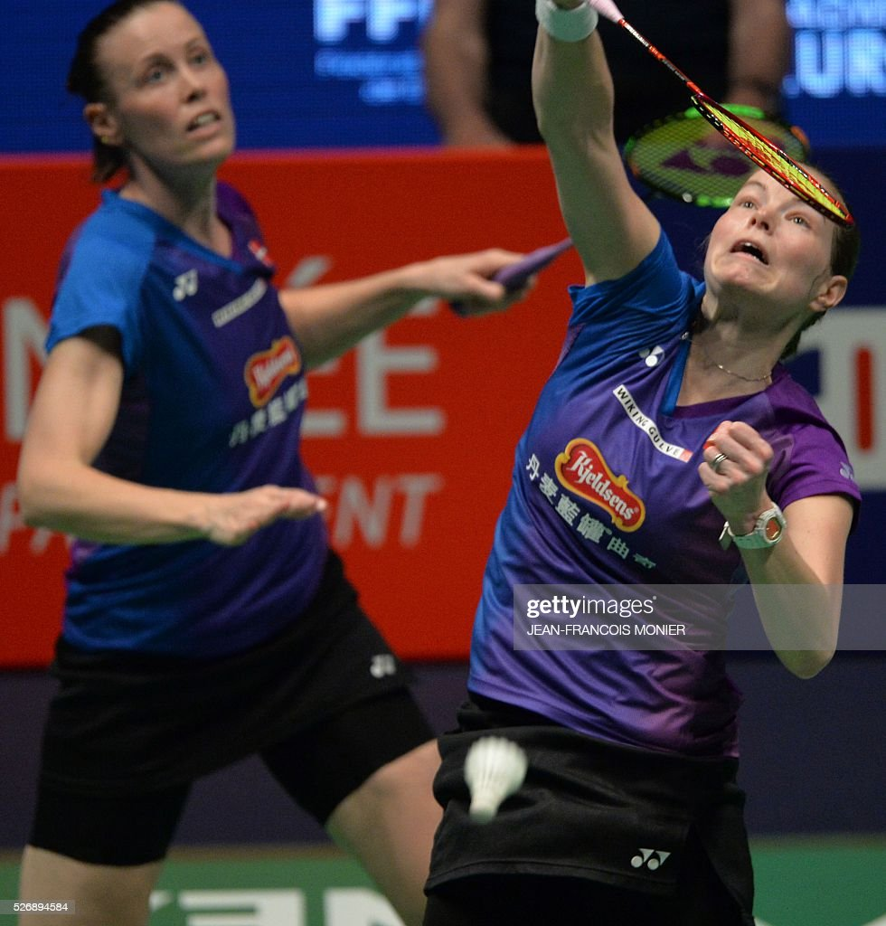 Denmark's Christinna Pedersen (R) and teammate Kamilla Rytter Juhl return the ball to Dutch Eefje Muskens and teammate Selena Piek during their 2016 European Championships Badminton double women's final match, between Denmark and Netherlands, on May 1, 2016 in Mouilleron-le-Captif, western France. / AFP / JEAN