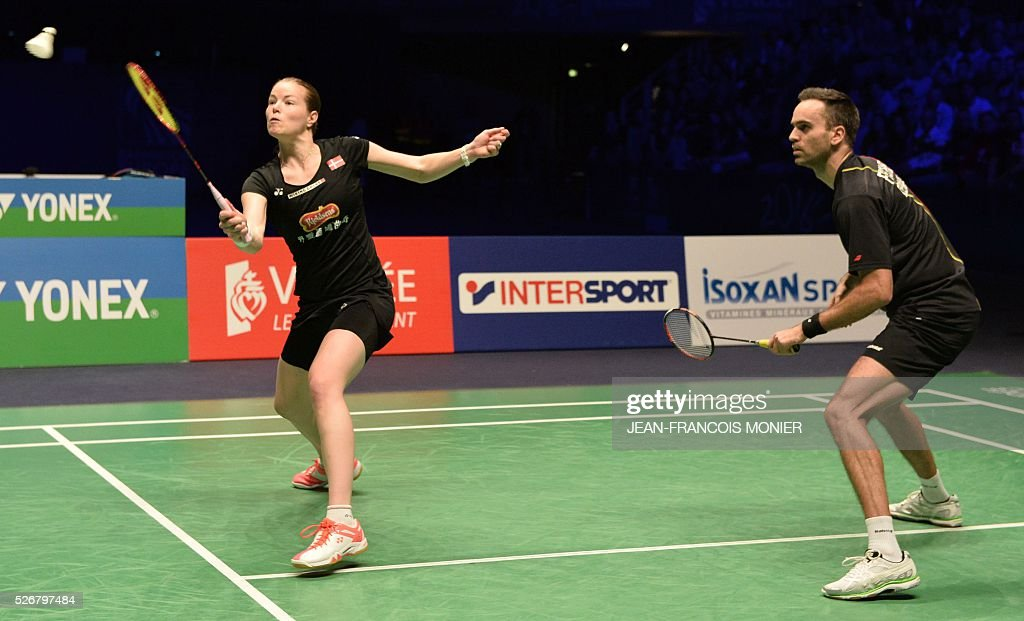 Denmark's Christinna Pedersen (L) flanked by teammate Joachim Fischer Nielsen returns the ball to Denmark's Niclas Nohr and teammate Sara Thygesen during their 2016 European Championships Badminton mixed doubles final match in Mouilleron-le-Captif, western France, on May 1, 2016. / AFP / JEAN