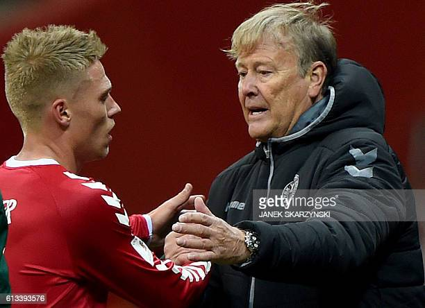 Denmark's coach Age Hareide talks with his player Viktor Fisher during the 2018 World Cup qualifier football match of Poland vs Denmark in Warsaw...