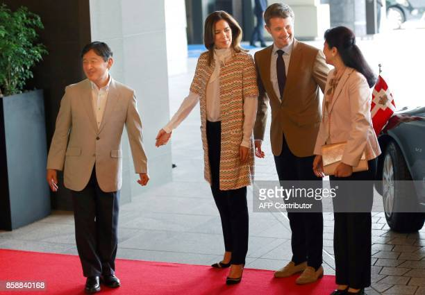 Denmark's Crown Prince Frederik and Crown Princess Mary are welcomed by Japan's Crown Prince Naruhito and Princess Masako at a hotel in Tokyo on...
