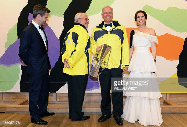 Denmark's Crown Prince Frederik and Crown Princess Mary pose with Erik Thorsted and Stig Kjerulf winners of the Social Award during the Crown Prince...