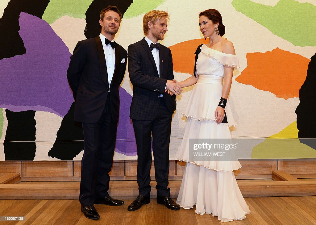 Denmark's Crown Prince Frederik (L) and Crown Princess Mary (R) pose with violinist Rune Tonsgaard Sorensen (C), joint winner of the Rising Star Award, during the Crown Prince Couple Awards 2013 in Sydney on October 28, 2013. The royal couple are on a five-day official visit to Australia to celebrate the 40th birthday of the Sydney Opera House, designed by Danish architect Yorn Utzon. AFP PHOTO/POOL/William WEST