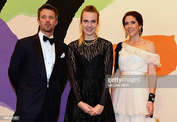 Denmark's Crown Prince Frederik and Crown Princess Mary pose with singersongwriter Karen Marie Orsted joint winner of the Rising Star Award during...