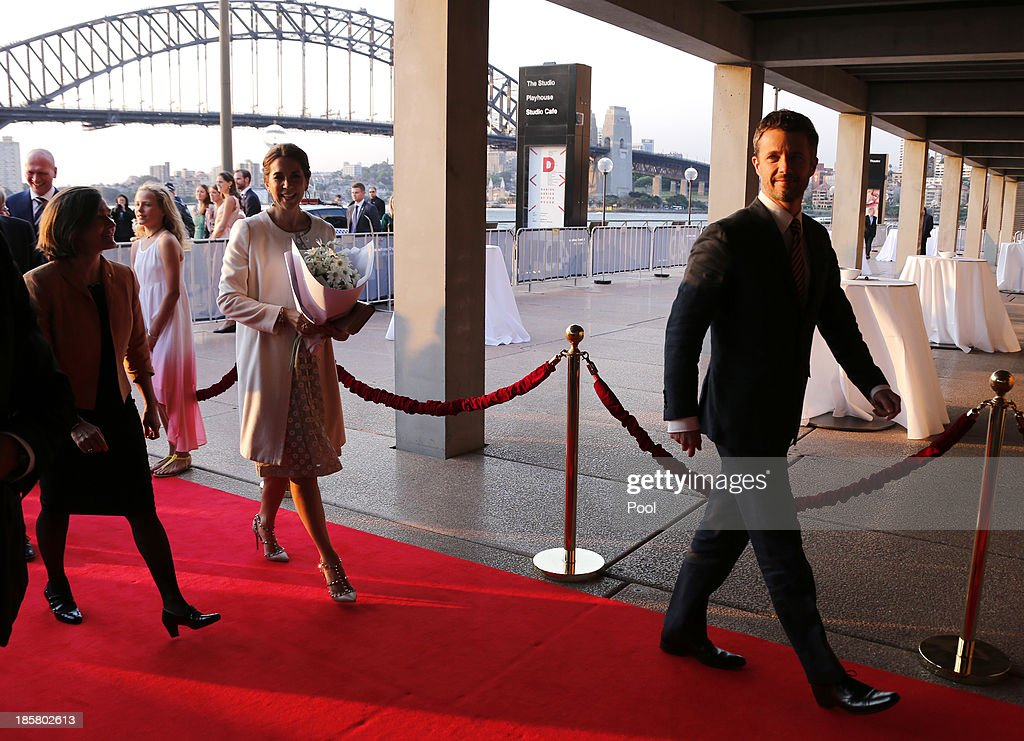 Denmark's Crown Prince Frederik (R) and his Australian wife Crown Princess Mary (2nd L) walk along the red carpet as they enter the Sydney Opera House on October 25, 2013 in Sydney, Australia. Prince Frederik and Princess Mary are visiting Sydney for five days and will attend events to celebrate the 40th anniversary of the Sydney Opera House and the Danish architect who designed the landmark, Jorn Utzen.