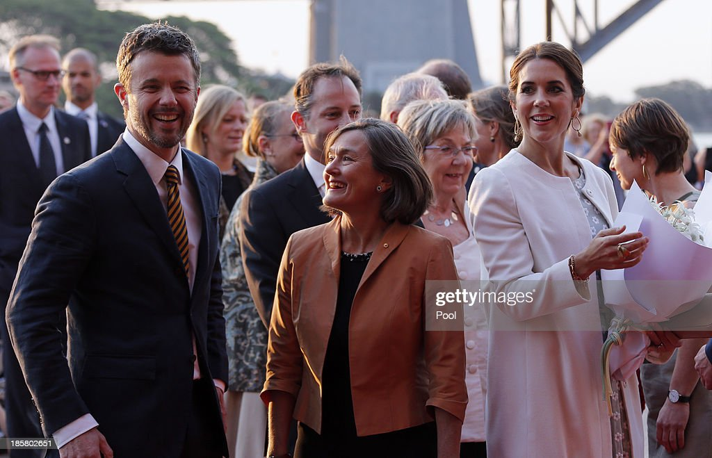 Denmark's Crown Prince Frederik (L) and his Australian wife Crown Princess Mary (R) arrives at the Sydney Opera House on October 25, 2013 in Sydney, Australia. Prince Frederik and Princess Mary are visiting Sydney for five days and will attend events to celebrate the 40th anniversary of the Sydney Opera House and the Danish architect who designed the landmark, Jorn Utzen.