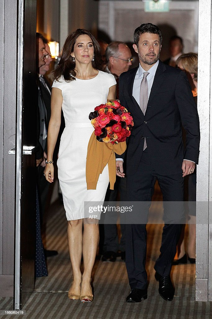 Denmark's Crown Prince Frederik (R) and his Australian wife Crown Princess Mary arrive for an offical ceremony of the Diploma of the Danish Export Association and His Royal Highness Prince Henrik's Medal of Honour to ECCO Shoes Pacific in Sydney on October 28, 2013. Prince Frederik and his whife Princess Mary are on a 5-day visit to Australia to celebrate the 40th anniversary of the Sydney Opera House. AFP PHOTO / POOL / Brendon Thorne
