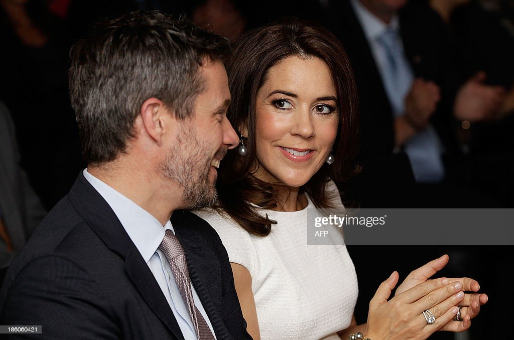 Denmark's Crown Prince Frederik (L) and his Australian wife Crown Princess Mary attend an offical ceremony of the Diploma of the Danish Export Association and His Royal Highness Prince Henrik's Medal of Honour to ECCO Shoes Pacific in Sydney on October 28, 2013. Prince Frederik and his whife Princess Mary are on a 5-day visit to Australia to celebrate the 40th anniversary of the Sydney Opera House. AFP PHOTO / POOL / Brendon Thorne